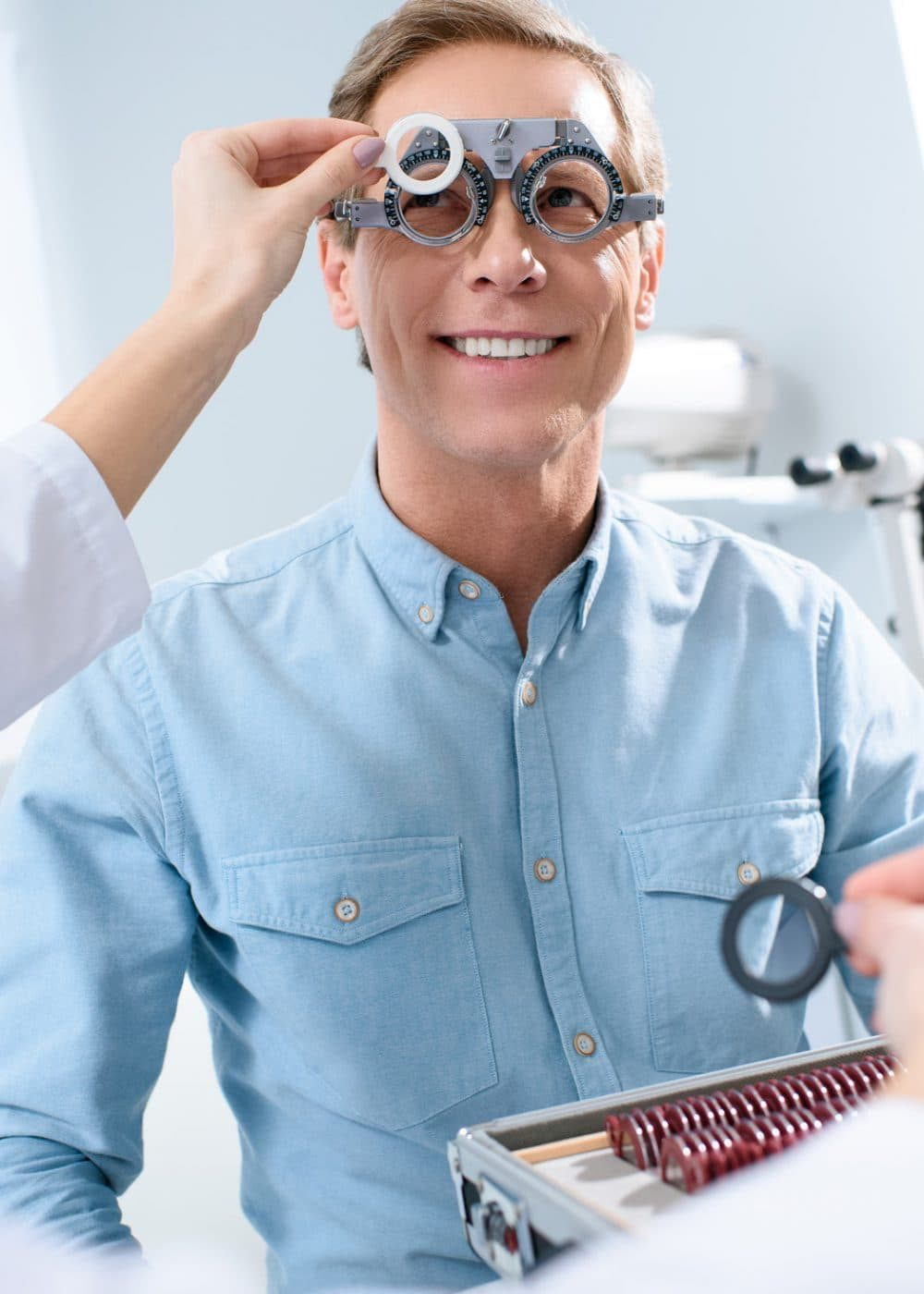 ophthalmologist-examining-middle-aged-man-eyes-with-trial-frame-and-lenses-pcpj4y7evmu461sqpjvsvb97n7s5pvlkzly8cb4rsg-pichi@2x