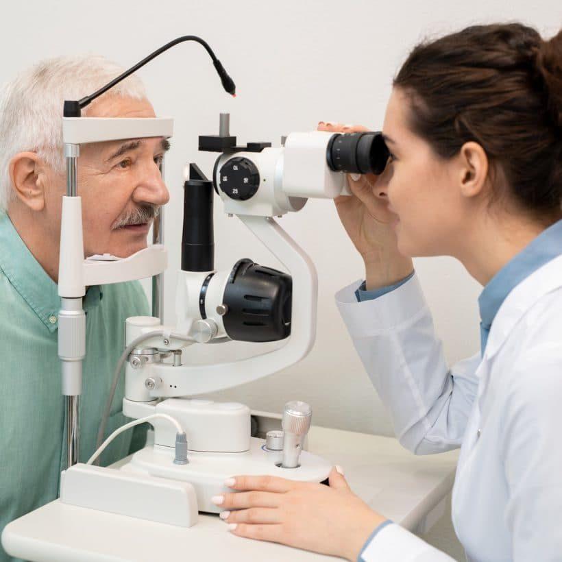 young-brunette-female-ophthalmologist-testing-eyesight-of-senior-male-patient-pcpj5bd3cdg9xt7radamwuokk0lk0xcsq8udvtmd54-pichi